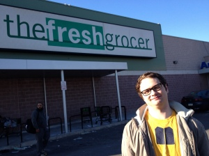 Student Alex Miller poses in front of The Fresh Grocer after he stopped to pick up food for the week